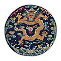 An embroidered midnight-blue silk dragon roundel, 18th century