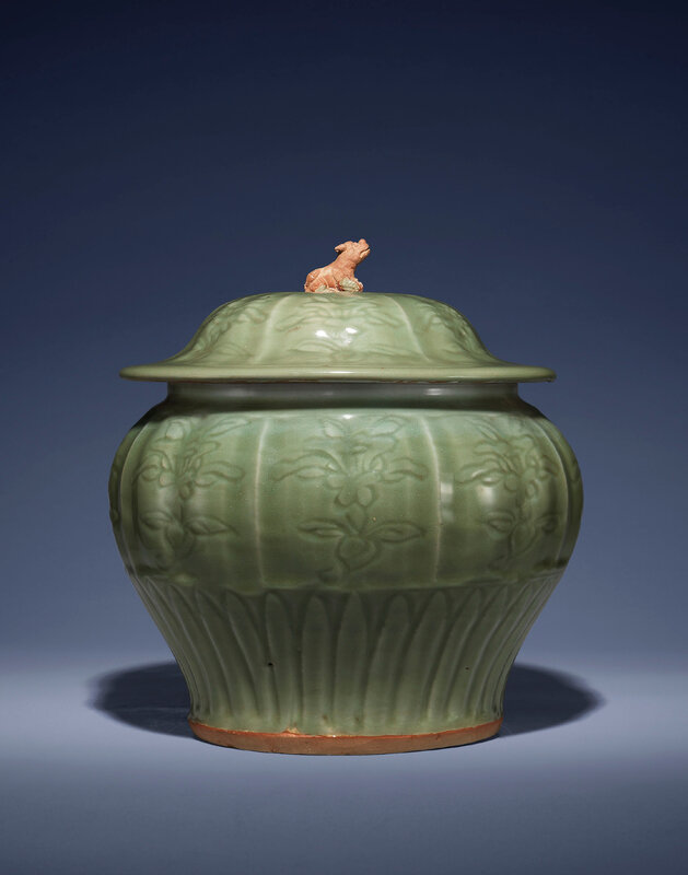 A carved 'Longquan' celadon jar and cover, guan, Yuan Dynasty (1279-1368)
