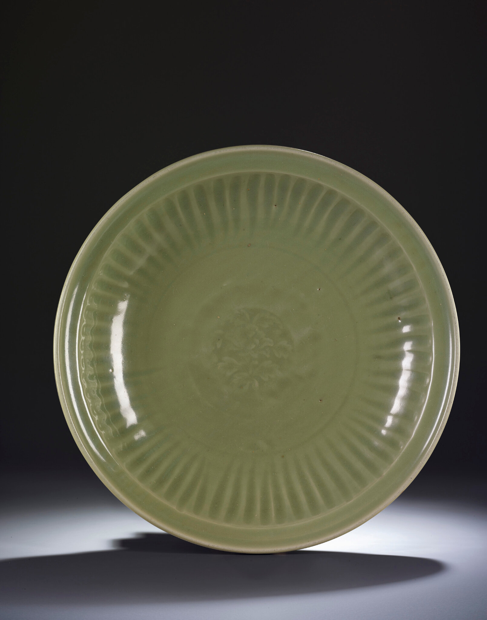 A large Longquan celadon carved 'peony' charger, Ming dynasty, 15th century