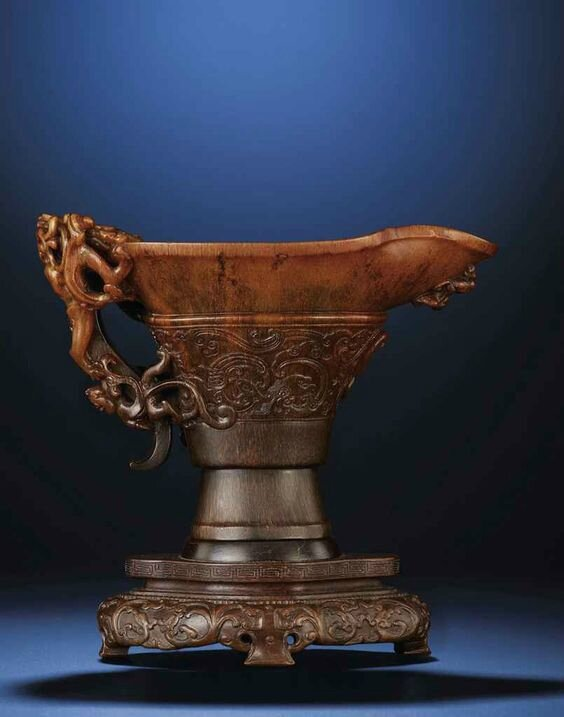 An exquisitely carved archaistic 'chilong' rhinoceros horn libation cup, Ming dynasty, early 17th century
