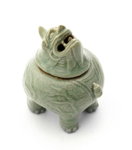 A Longquan celadon-glazed 'luduan' incense burner and cover, 16th century
