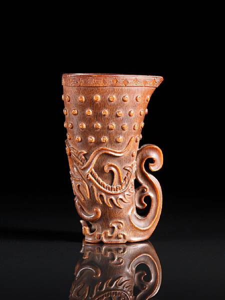 A fine and rare rhyton-form 'dragon' rhinoceros horn libation cup. 17th-18th century