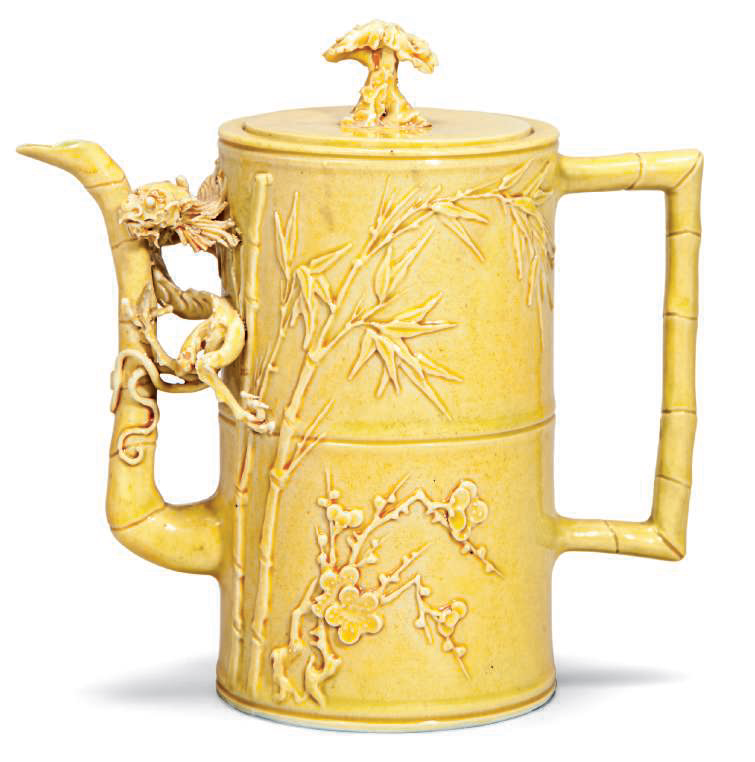 A yellow glazed carved ewer, late 19th century