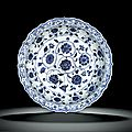 A rare barbed 'floral scroll' blue and white dish, Ming dynasty, Y