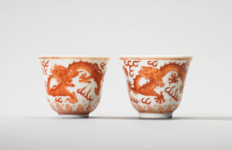 Two iron-red decorated 'dragon' wine cups, Guangxu six-character marks in underglaze blue and of the period (1875-1908)