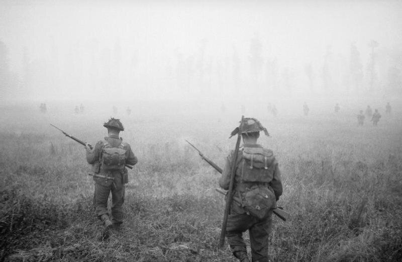 Infantry_of_'B'_Company,_6th_Royal_Scots_Fusiliers,_15th_(Scottish)_Division,_advance_during_Operation_'Epsom'_in_Normandy,_26_June_1944__B5957