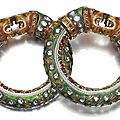 A large pair of enamelled bracelets with tiger heads, north india, 19th century