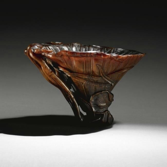 A finely carved rhinoceros horn libation cup, 17th century