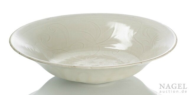 A large carved Dingyao lotus dish, probably Northern Song (960-1127) or Jin dynasty (1115-1234), Dingyao, Hebei province