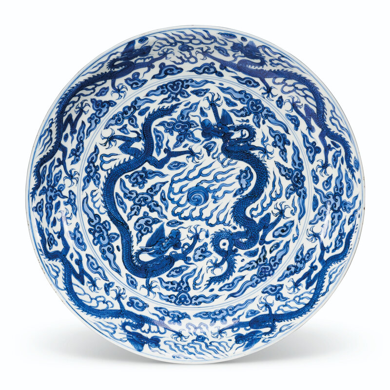 A large blue and white 'dragon' dish, Wanli six-character mark in underglaze blue within a double circle and of the period (1573-1619)