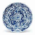 A large blue and white 'dragon' dish, wanli six-character mark and of the period (1573-1619)
