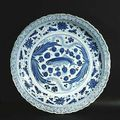 A very important blue and white porcelain fish plate with water plant design. china, yuan dynasty, 14th century