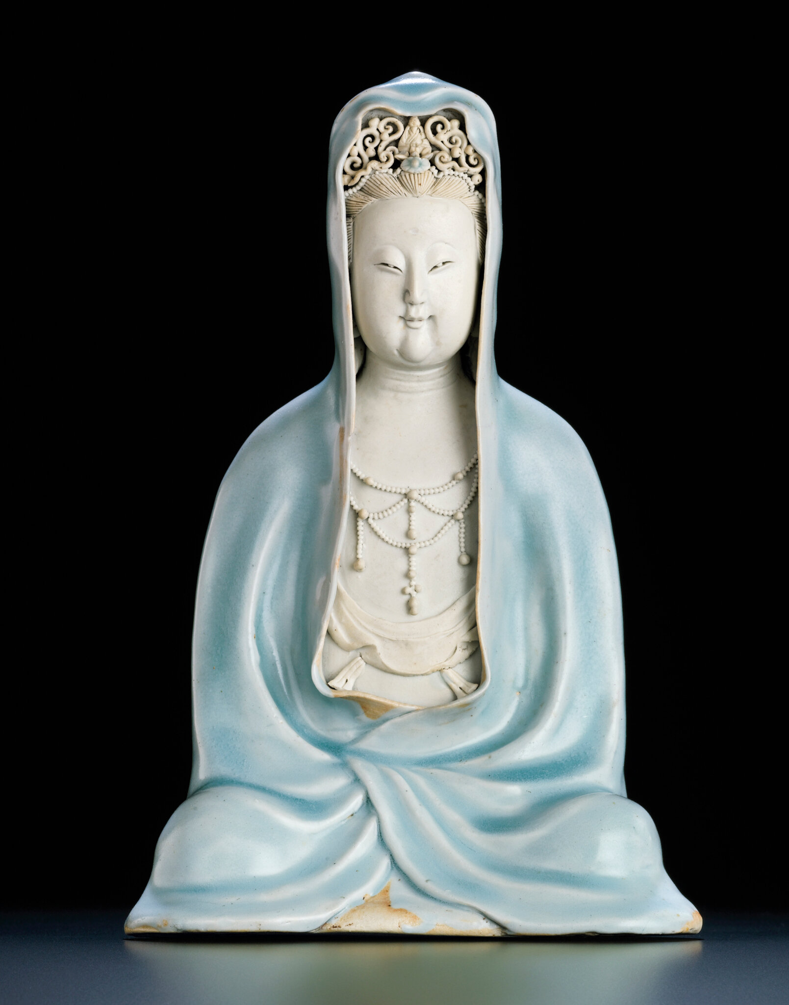 An exceptionally rare Qingbai seated figure of Guanyin, Southern Song dynasty (1127-1279)