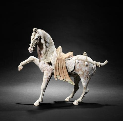 A large painted pottery model of a prancing horse, Tang Dynasty