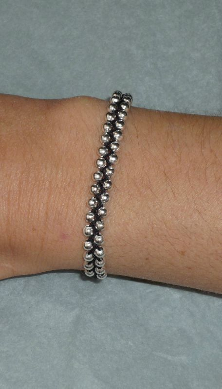 Bracelet argenté tissé noir