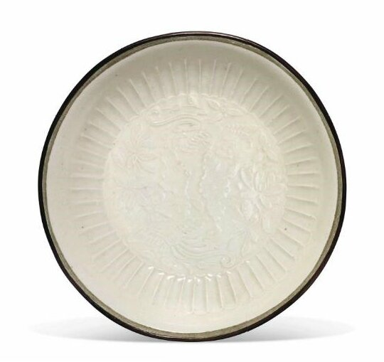 A rare small Ding moulded 'phoenix' dish, Jin dynasty (1115-1234)