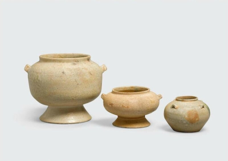 A group of three small glazed containers with green enamel splashes, Hán Việt period, 1st-4th centuries