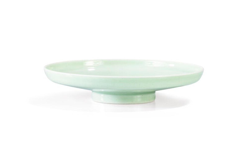 A celadon-glazed footed dish with an incised lotus scroll design, Yongzheng mark and period (1723-1735)