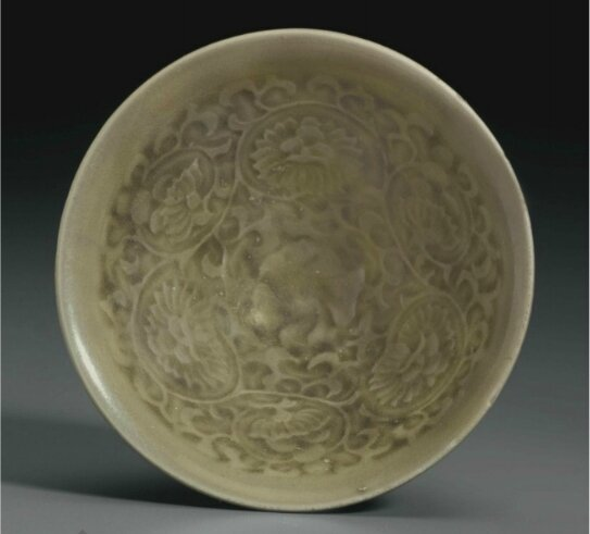 A small Yaozhou celadon molded conical bowl, China, Northern Song-Jin Dynasty, 12th-13th century