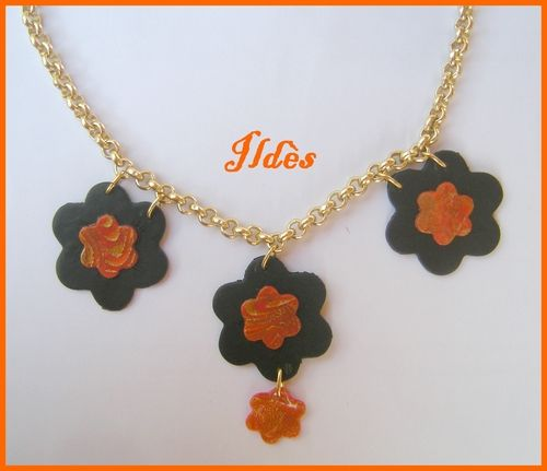 fimo collier fleurs orange noir 1