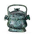 An archaic bronze ritual wine vessel and cover, you, western zhou dynasty, 1050-771 b.c.