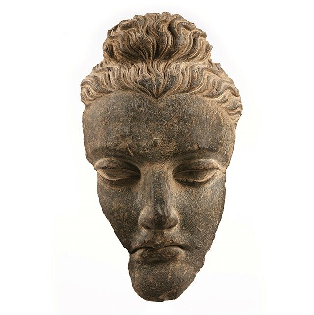 A 3rd century Gandhara grey schist head of the Buddha from Afghanistan