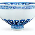 A blue and white ming-style 'lotus' bowl, kangxi six-character mark in underglaze blue in double circle and of the period