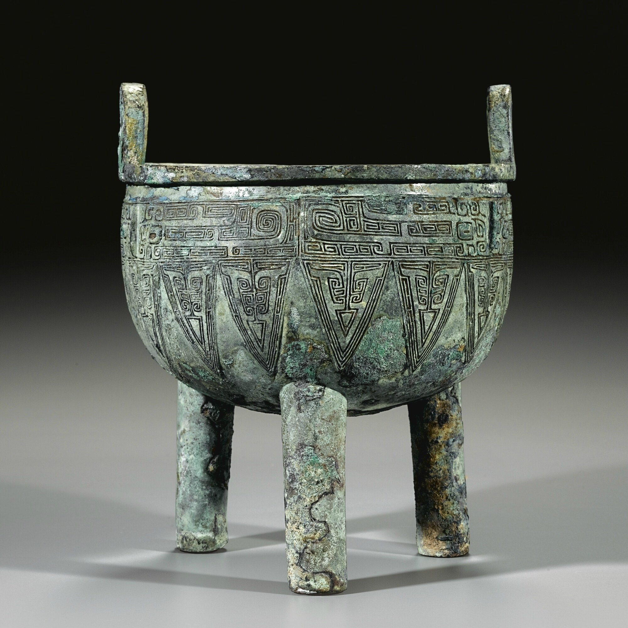 An archaic bronze ritual food vessel, ding, Late Shang dynasty (c