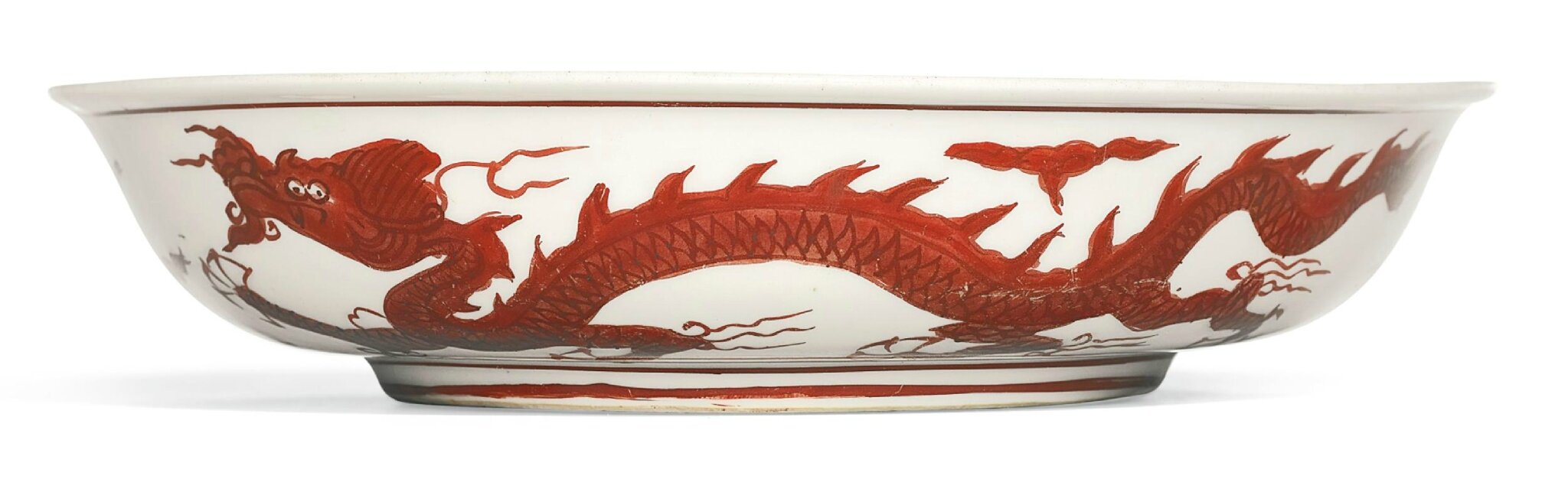 An iron-red painted 'dragon' dish, mark and period of Jiajing