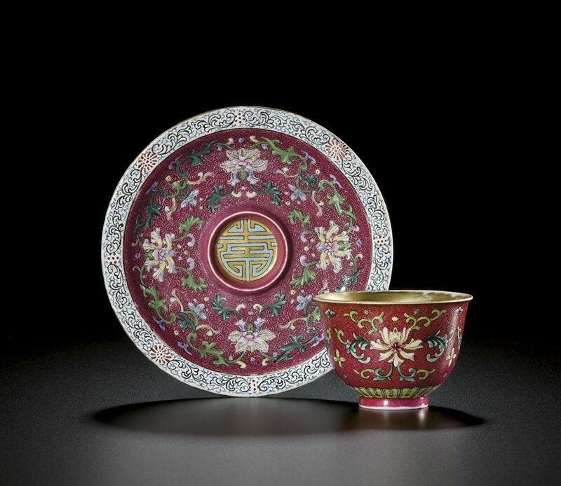 A rare famille-rose ruby ground wine cup and saucer, Seal mark and period of Qianlong (1736-1795)
