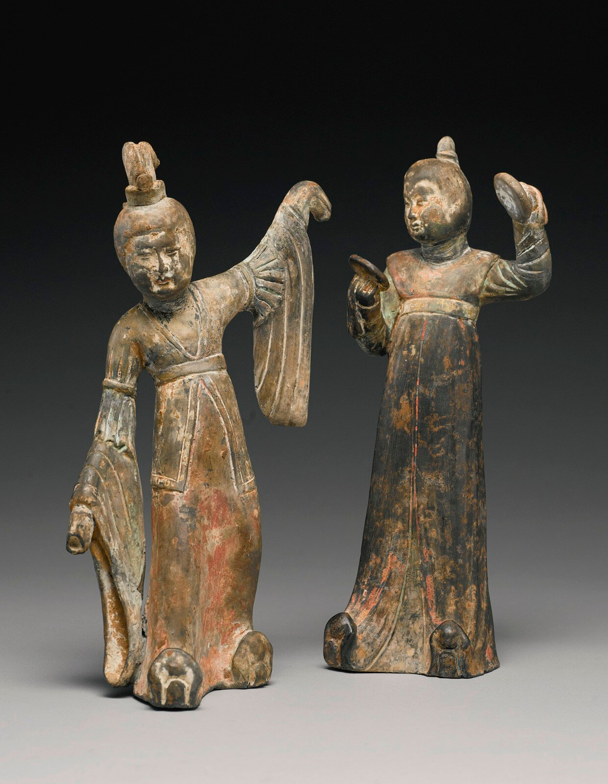 Two painted gray pottery figures of female attendants, Early Tang dynasty (618-907)