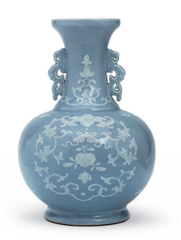 A white slip-decorated pale blue-glazed vase, Qianlong six-character seal mark in underglaze blue and of the period (1736-1795)