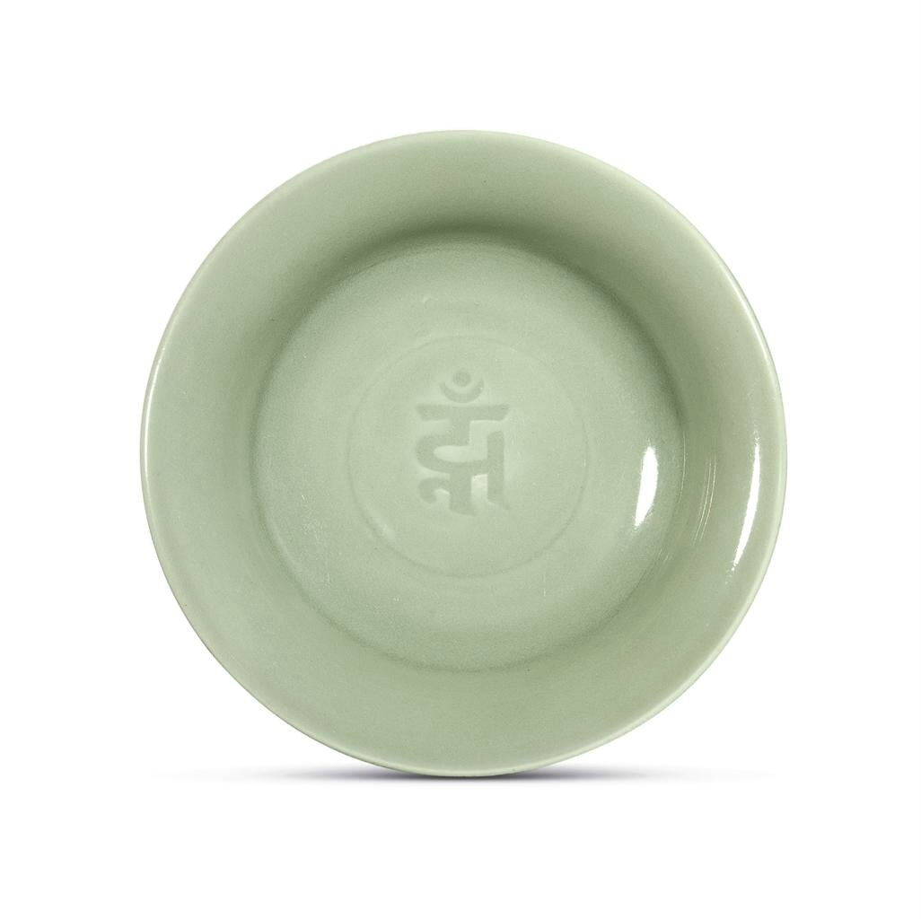 A fine and rare Longquan celadon 'sanskrit' dish, Yuan-Early Ming dynasty, 14th-15th century