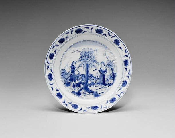 A blue and white 'Adam and Eve' saucer dish, Kangxi period (1662-1722)