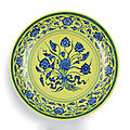 A rare underglaze-blue and yellow-enamelled 'lotus bouquet' dish, mark and period of yongzheng (1723-1735)
