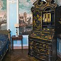 A chinese export black and gilt lacquer bureau bookcase, mid-18th century