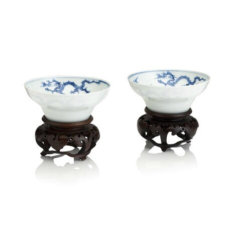 A pair of blue and white ogee-shaped 'dragon' bowls. Bearing a Chenghua six character mark, but Kangxi. Photo Bonhams.