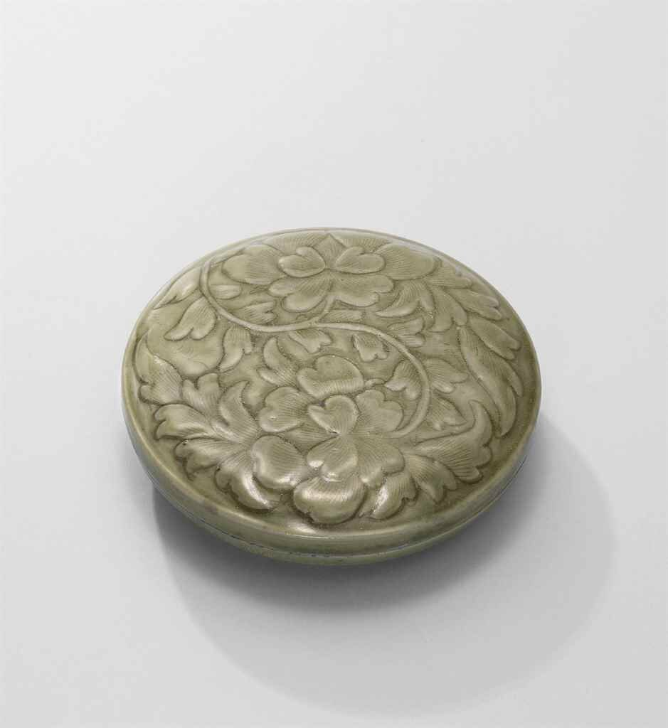 A Yue celadon carved and moulded 'peony' circular box and cover, Northern Song dynasty (960-1127)