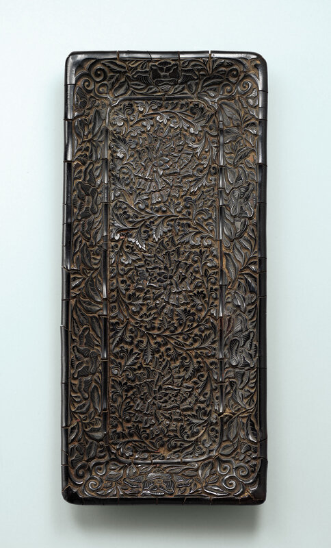 A carved black lacquer 'floral' rectangular scroll tray, Late Southern Song-Yuan dynasty, 13th-14th century