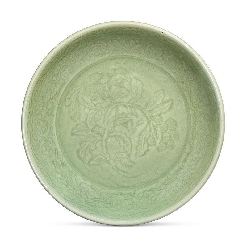 A rare Longquan celadon carved 'lychee' dish, Yongle period (1403-1425)