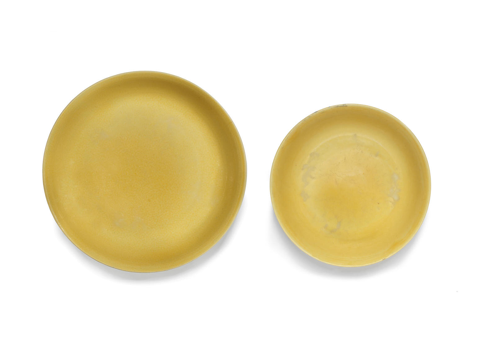 Two rare yellow-glazed saucer-dishes, Zhengde six-character marks and of the period (1506-1521)