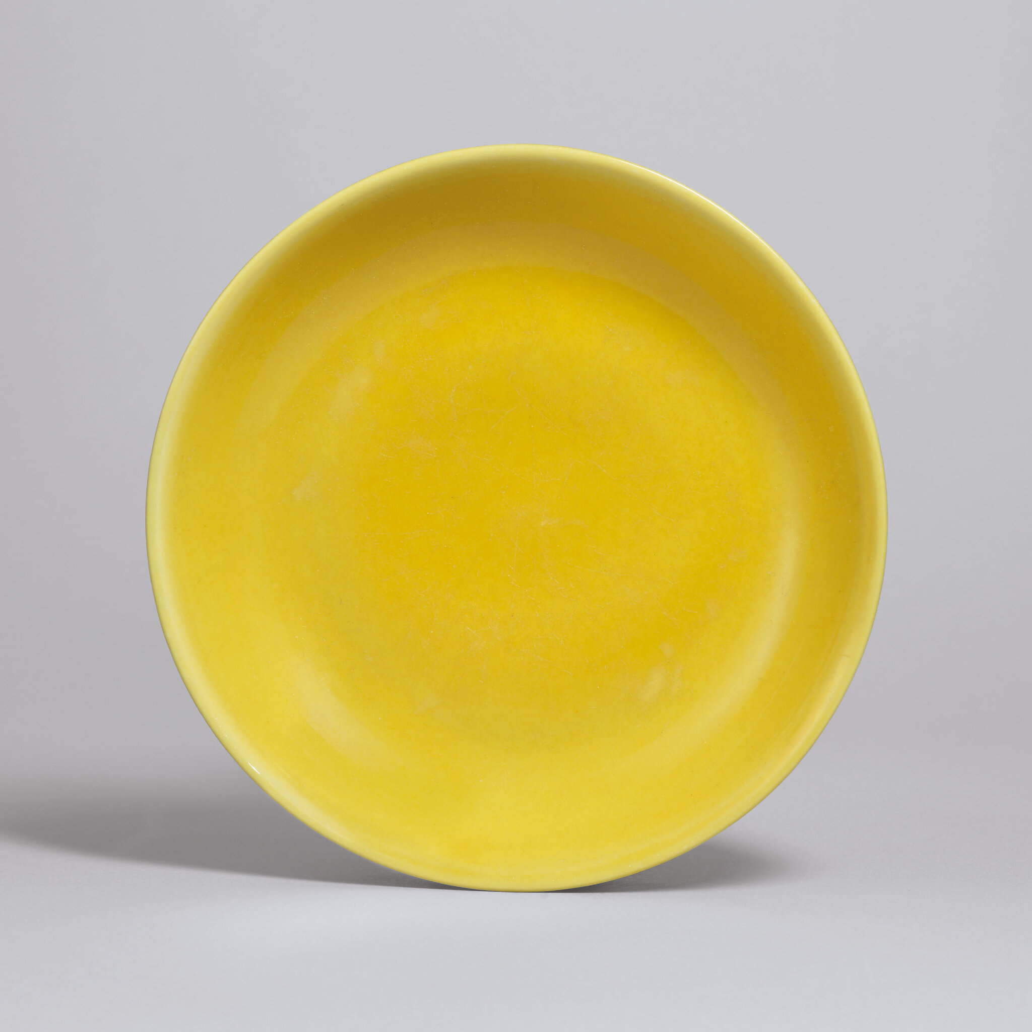 A yellow-enamelled dish, Zhengde six-character mark in underglaze blue within a double circle and of the period (1506-1521)