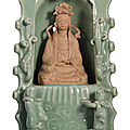 An unusual celadon-glazed and biscuit shrine of guanyin, early ming dynasty