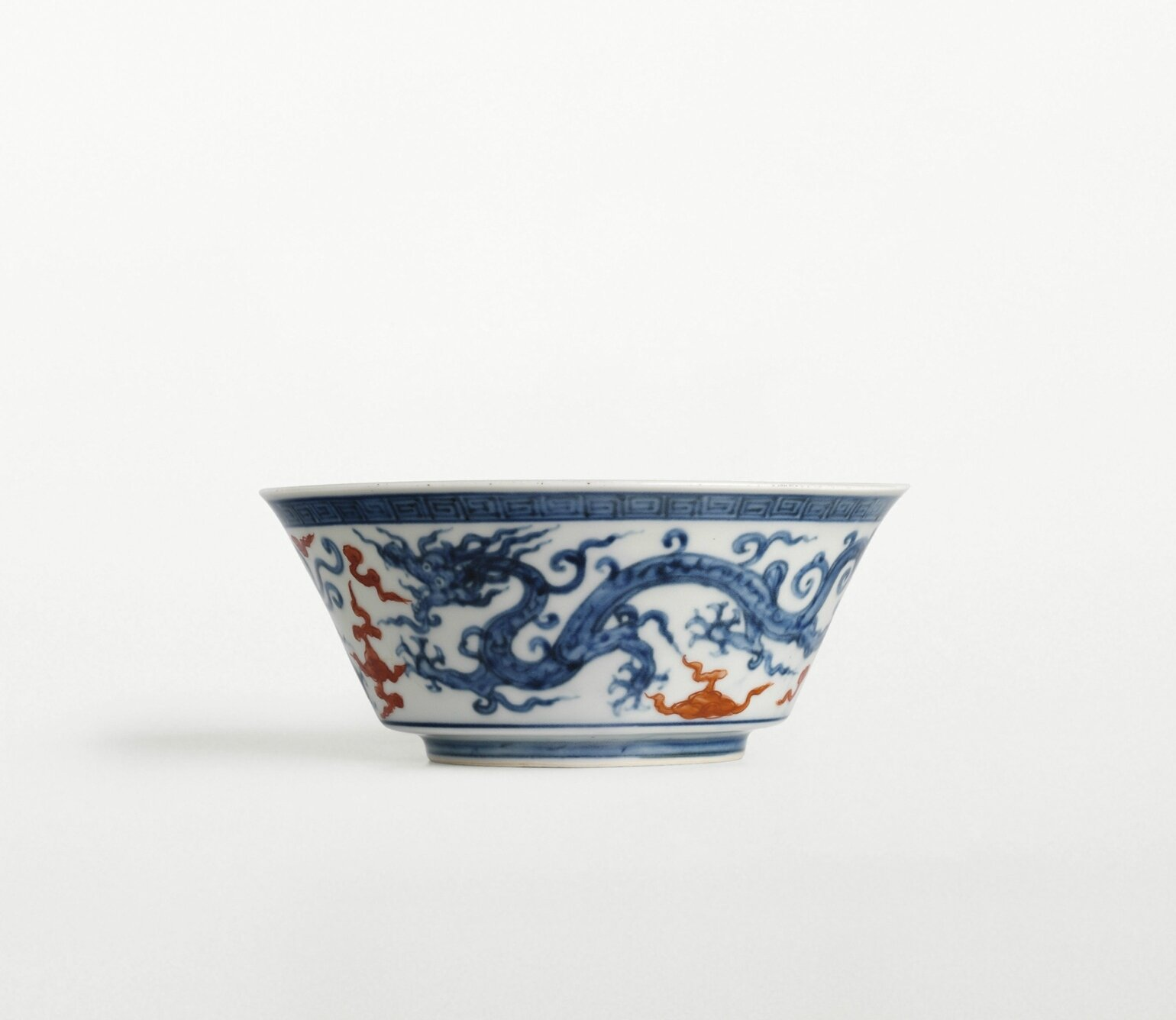 An unusual blue and white 'Dragon' bowl with red clouds, mark and period of Zhengde
