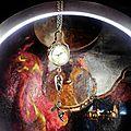 Sautoir montre boule surmontant une goutte de pyrite, une fée et une branche fleurie...
