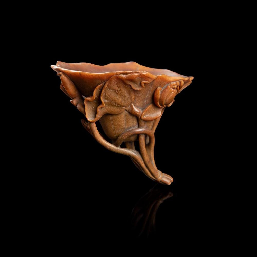 Rare well-carved rhinoceros horn 'lotus' libation cup, Qing dynasty, 17th century