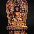A rare gilt-lacquered wood figure of buddha enthroned, 17th-18th century
