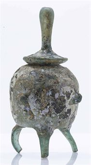 a_very_rare_iridescent_pale_green_glass_tripod_reliquary_jar_and_cover_d5379583h