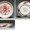 An iron-red-decorated 'dragon' dish, iron-red Zhengde four-character mark within a double circle and of the period (1506-1521)