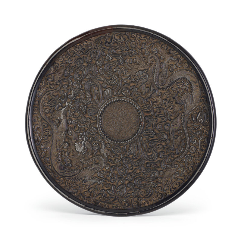 A rare carved black lacquer circular dish, Ming dynasty (1368-1644)